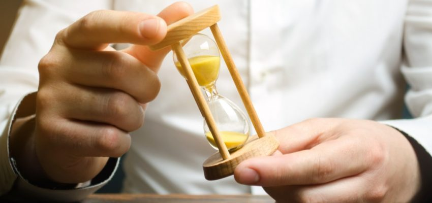 businessman-holds-clock-in-hands-concept-of-saving-time-and-money-time-management-planning-work_t20_YwgnGO