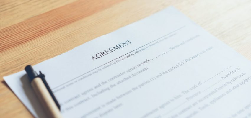 closeup-of-signing-a-documentation-agreement-and-pen-on-the-table_t20_YwR1v4
