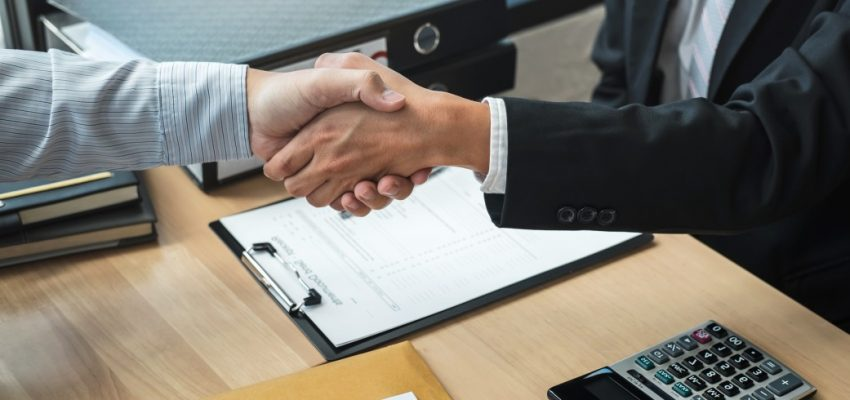 handshake-after-finishing-conversation-businessman-sending-a-resignation-letter-to-employer-boss-in_t20_pRExdW