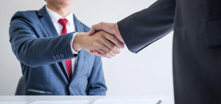 meeting-and-greeting-concept-two-confident-business-handshake-and-business-people-after-discussing_t20_kRV662