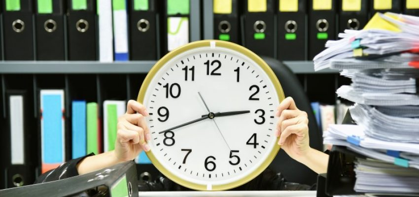 office-worker-holding-a-clock-working-overtime-and-lot-of-work-time-management-concept_t20_lo6yBk