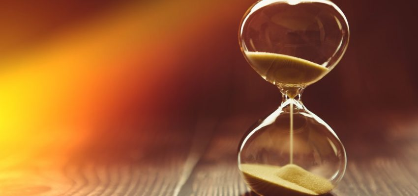 the-sunbeam-penetrates-the-hourglass-symbolizing-the-beginning-of-time-or-the-final-time-clock-on-a_t20_GJ0nAE