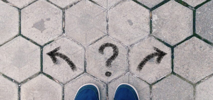 top-view-of-blue-shoes-on-tiled-pavement-with-question-mark-and-two-arrows-concept-of-crossroads-and_t20_jX7KKp